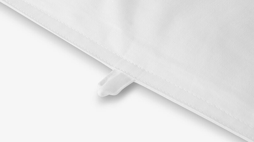8mm double wrap. Firm and secured. Two rows of 8mm white cotton thread stitches. Embroidery that is even and straight. Edges appear polished and clean.