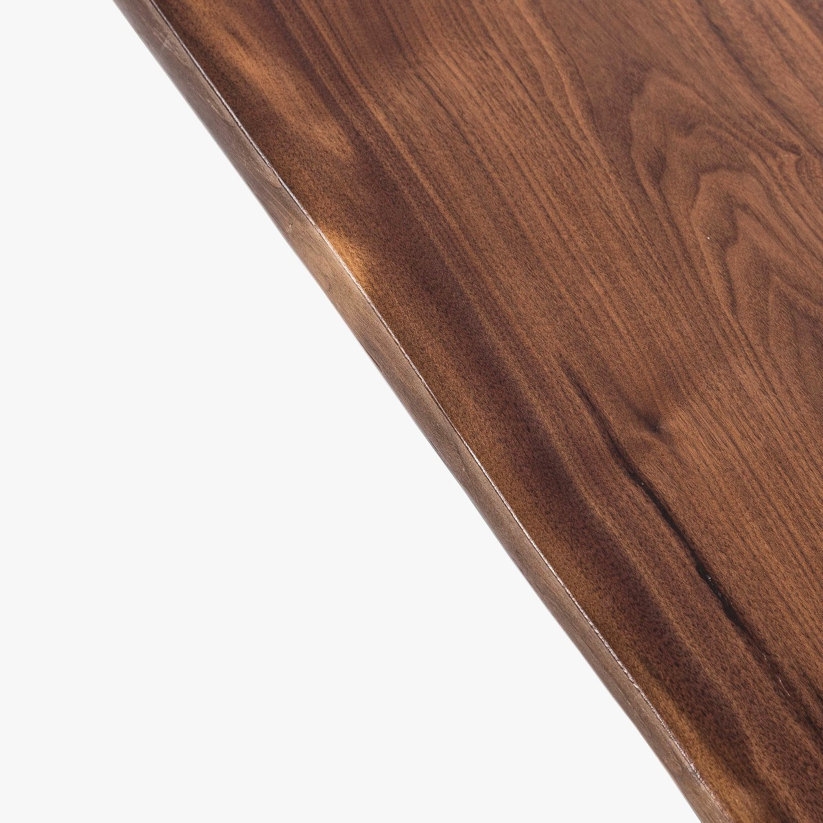 We have retained the live edge to honor the heritage of the wood.