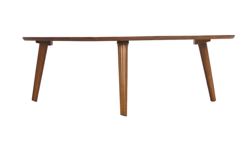 The coffee table is perched on tapered solid wood legs.