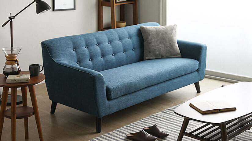 Cool toned sofa that adds a splash of colour to your space.