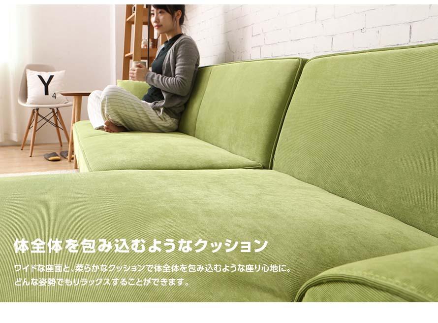 sitting down crossed legged on the dile sofa