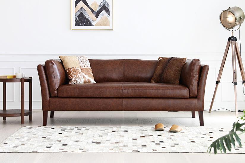 The Dusk Sofa in Ash Black PU leather.