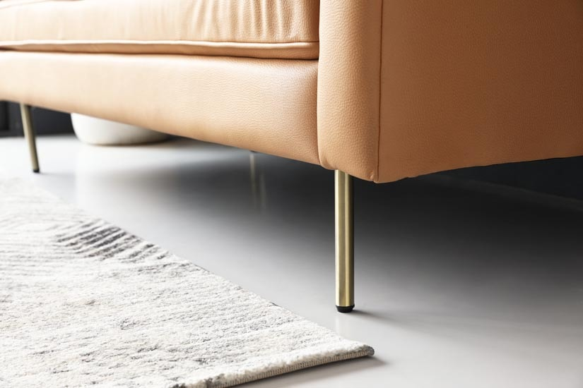 The sofa is supported by tall and sturdy, high-shine Zinc Alloy legs that add a touch of glamour to its overall design. It also is durable, corrosion-resistant and rust-proof.  The legs' tall height makes cleaning under the sofa an easy experience.