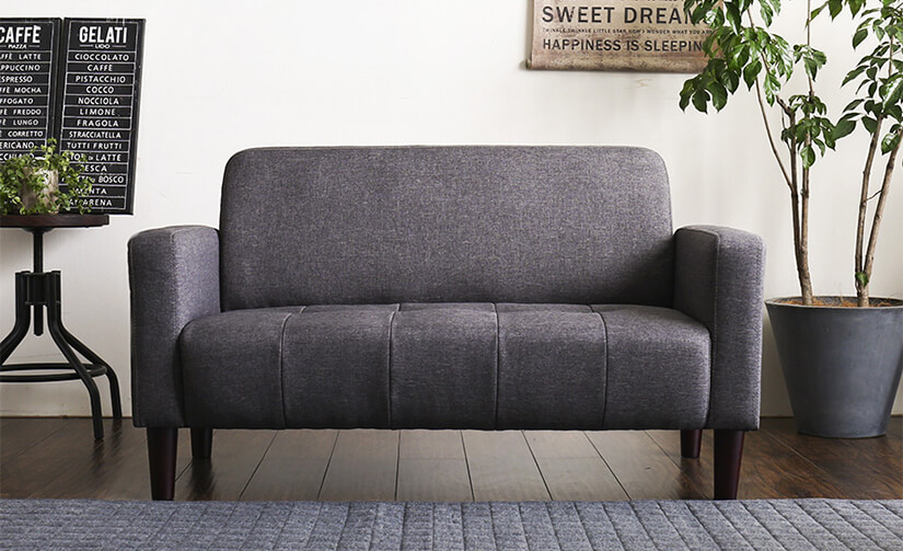 Modern silhouette with rounded edges. Timeless button tufting.