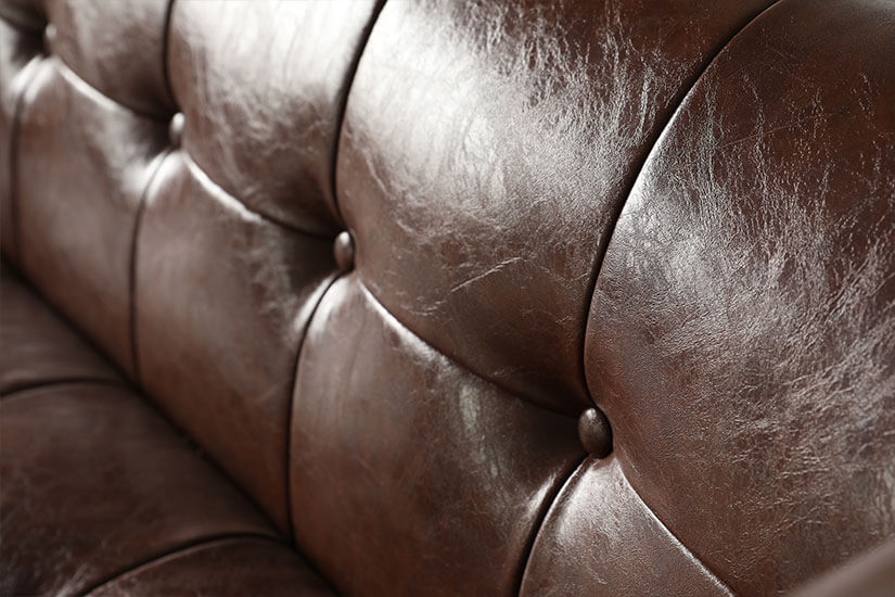 Button tuftings. Spread evenly across the sofa. A touch of mid-century flair