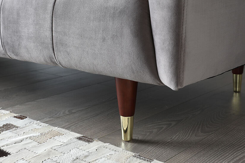 Solid wood legs. Tapered and rounded shape. Golden caps add a luxurious finish.