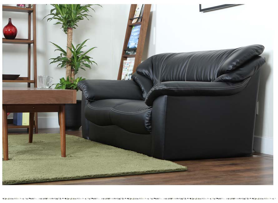 The Gracia Japanese Sofa in black leather's side view.