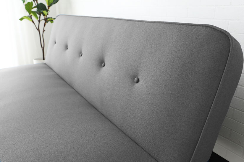 Accented with button tuftings. Little details that enhance the sofa's design.