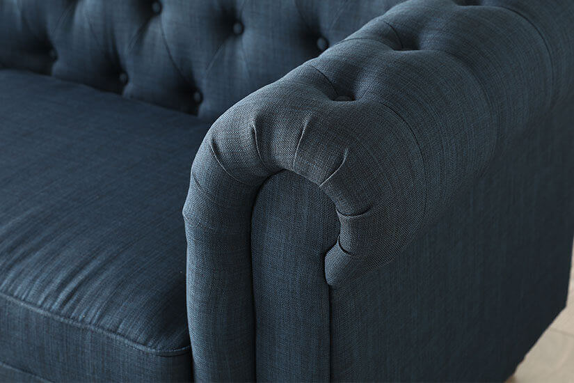 Rolled armrests. A distinct feature of a Chesterfield sofa design.