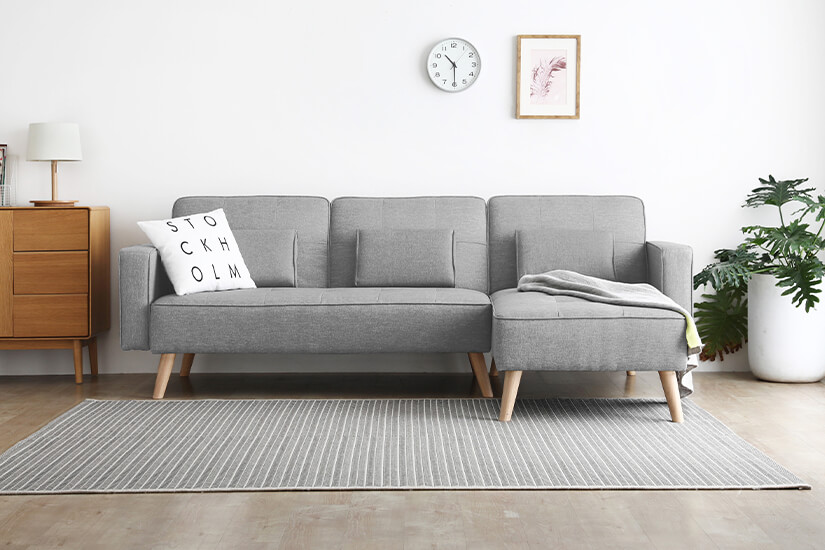Textured fabric upholstery. Legs made of solid wood. Versatile design that is easy to match.
