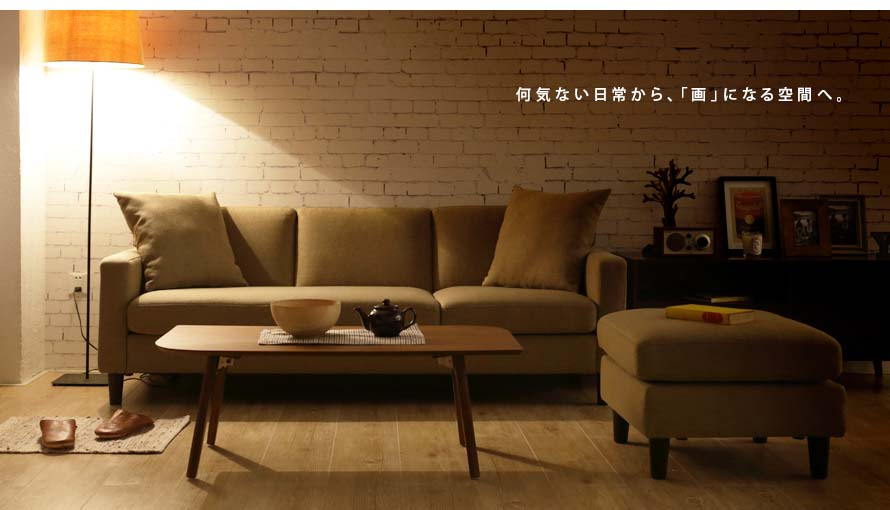 The Lisbon Sofa in evening setting under yellow light.