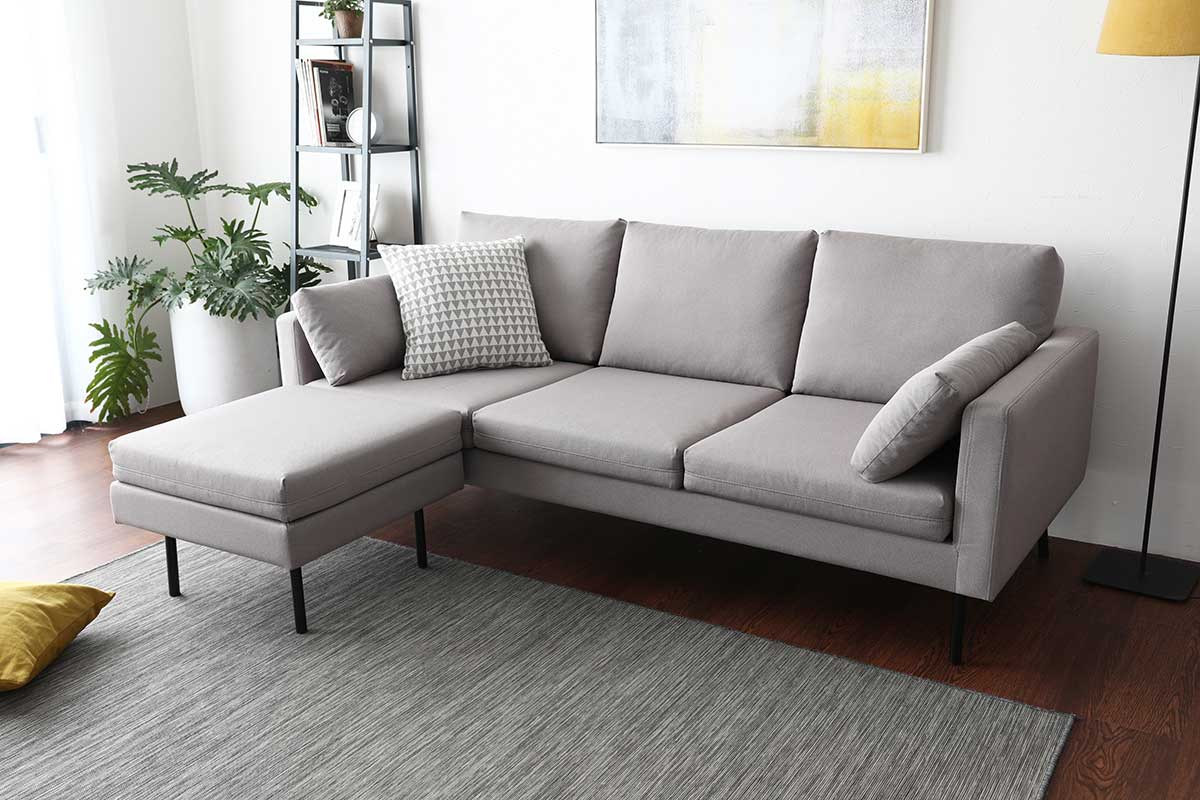 Create a lounge by connecting an ottoman to the sofa.
