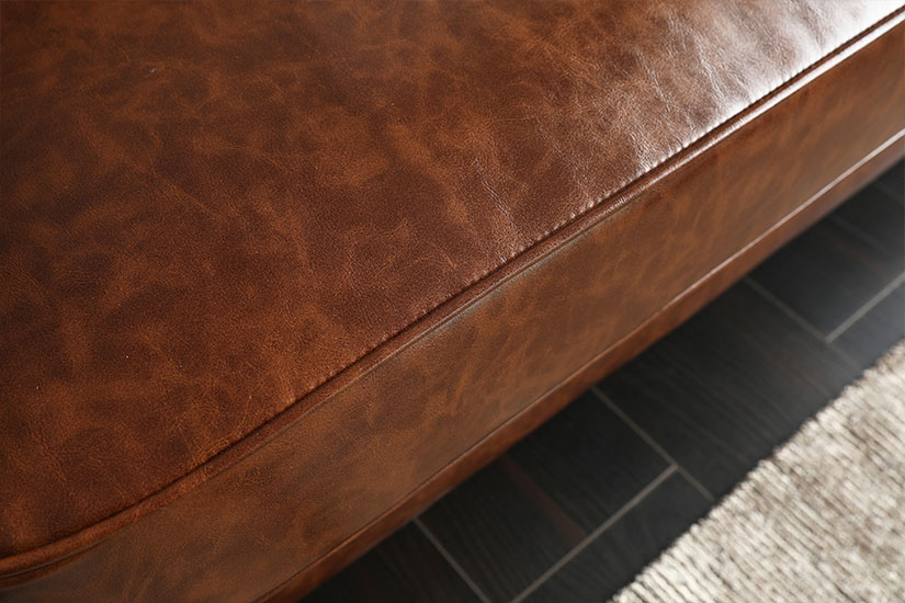PU leather. Smooth to touch. Distressed texture for a vintage appeal.