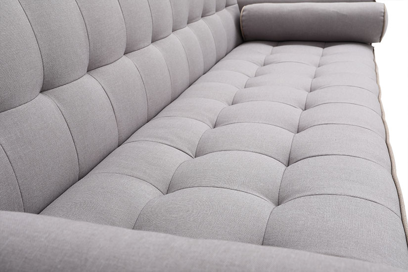 The tuftings highlight the sofa's elegance and add dimensionality to its overall design.