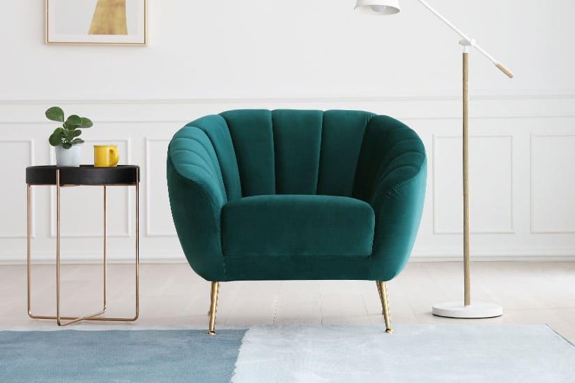 Timeless elegance. A harmonious pairing of gold legs and rich velvet upholstery.