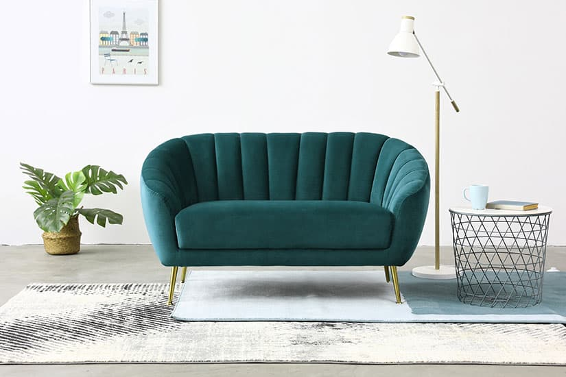Timeless elegance. A harmonious pairing of gold legs and rich velvet upholstery