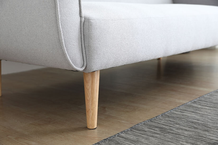 Sturdy support with wooden legs. Adding a touch of nature to its design.