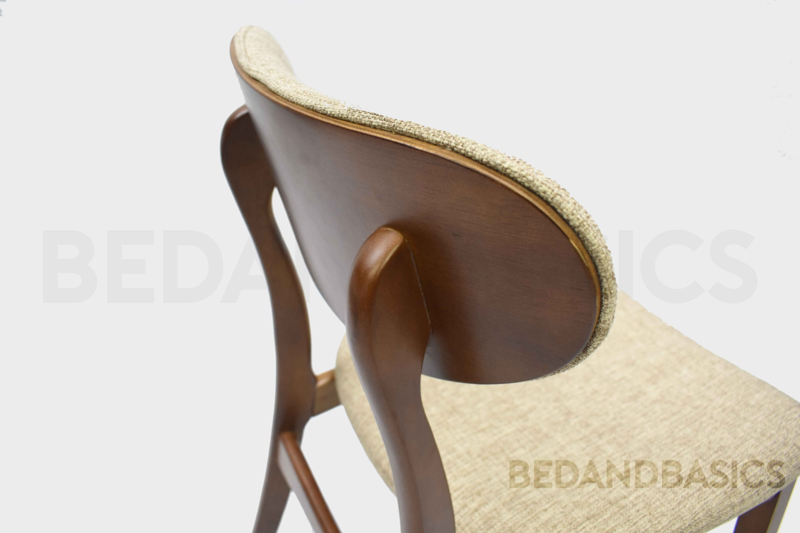 The seat and backrest are both slightly curved for maximum comfort. The curved wooden backrest is visually striking.