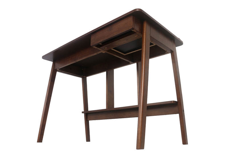 The study table is perched on strong and sturdy wooden legs.