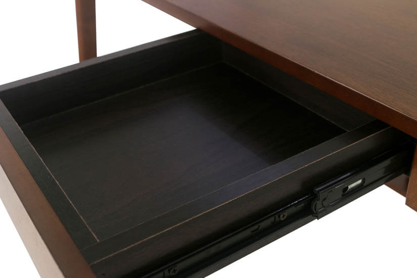 A small drawer with a particle board base for storing your stationery.