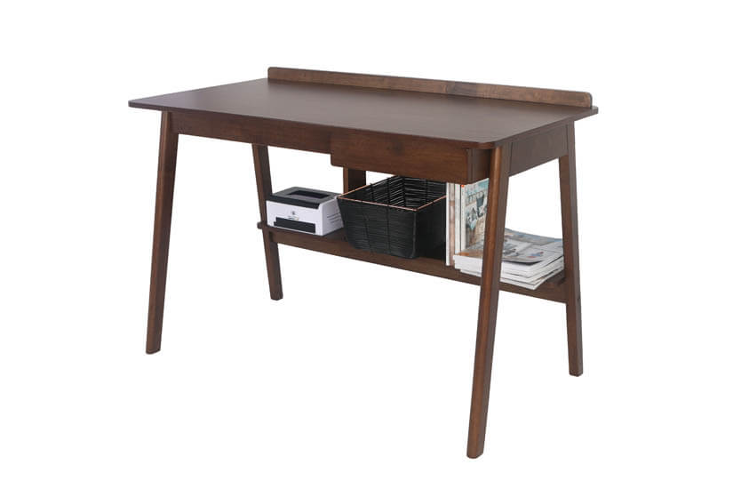 The table includes a lower shelf below for storing your files, books magazines, and more.