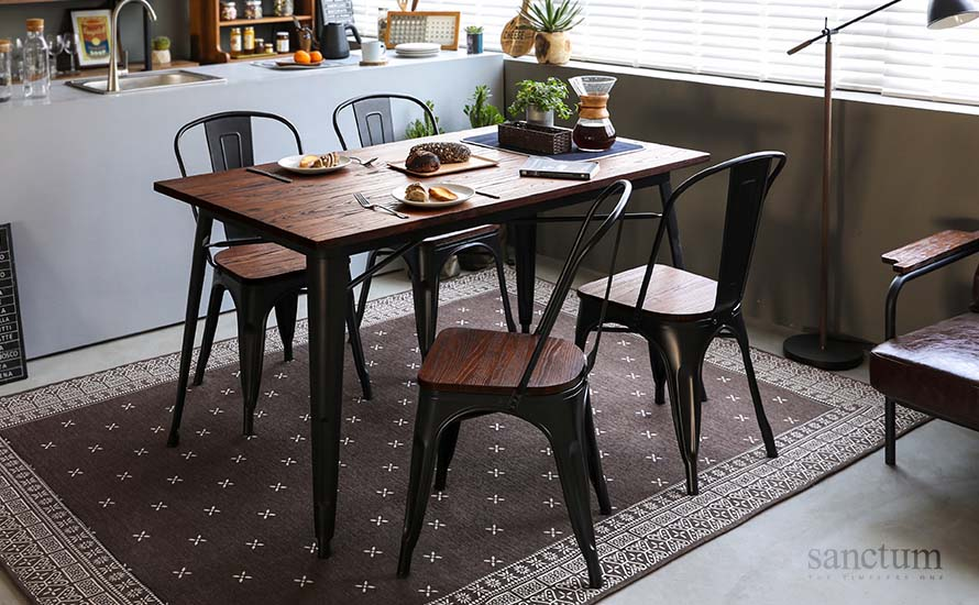 the sanctum solid wood table on a bandana  brown vintage rug