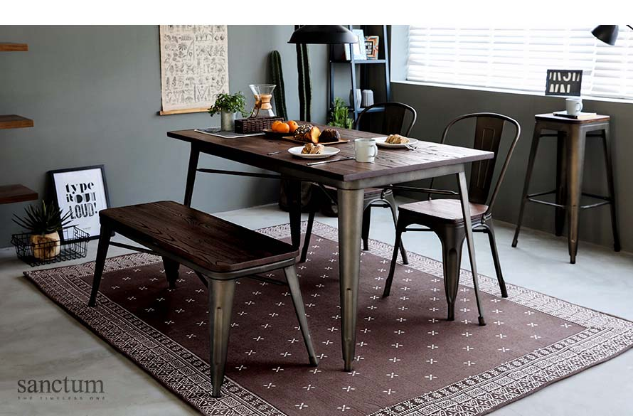 The sanctum vintage dining table on top of the bandana brown rug