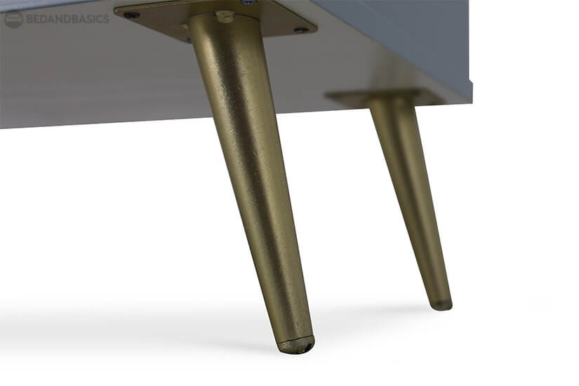 Round brass colored tapered legs made from sturdy metal alloy.