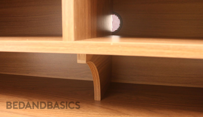 The interior of the cabinet is supported by beams that are designed with a slight curvature.