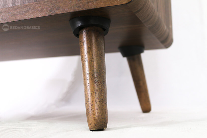 Round wooden tapered legs steadily supports the shoe cabinet.