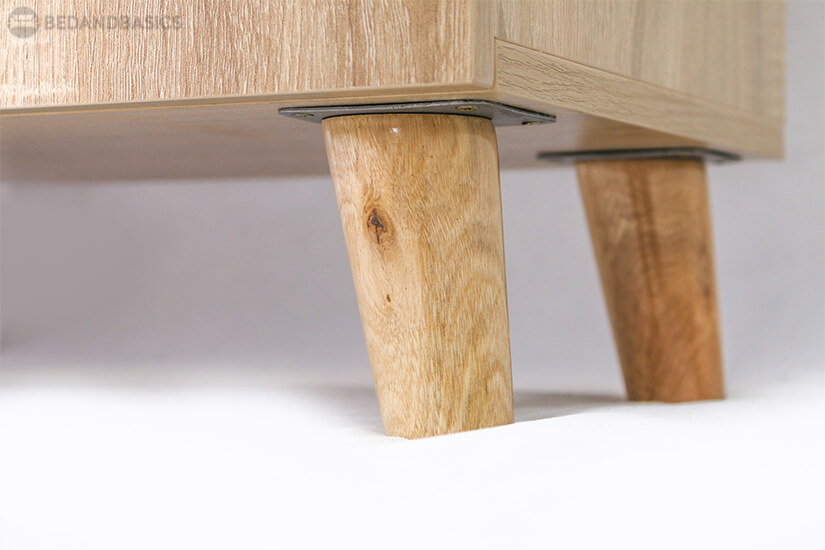 Wooden legs steadily support the shoe cabinet.