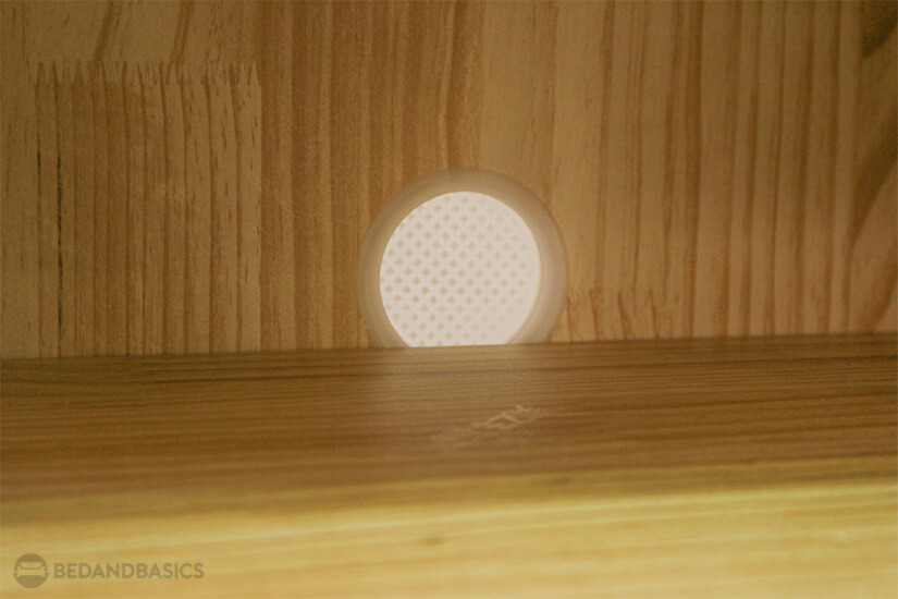 A non-intrusive hole is crafted in the cabinet for better ventilation.