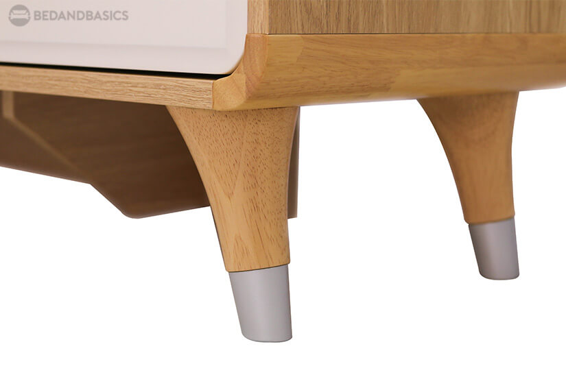 Sturdy legs with silver-finish details adds elegance to the design.