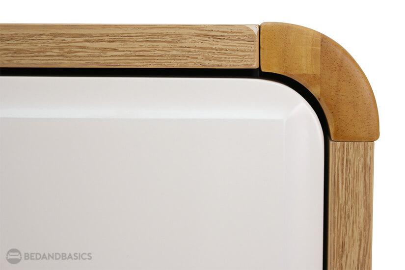 Curved edges give a unique silhouette to the shoe cabinet.
