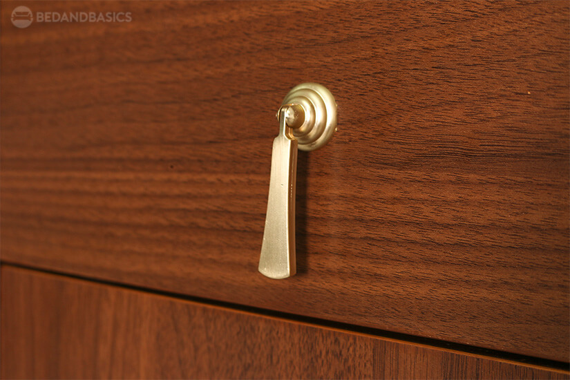 Gold-covered metal drawer pulls elevates the look of the cabinet.