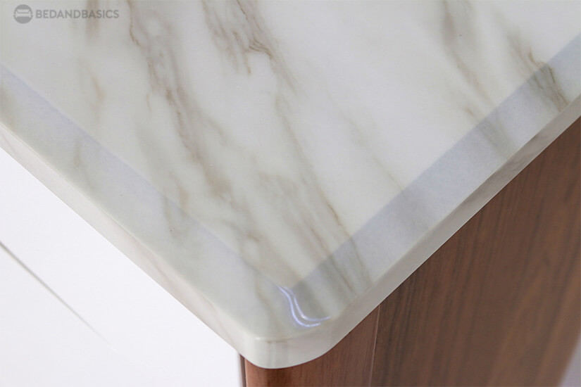 Cultured marble top exudes elegance. Perfect for modern luxury home.