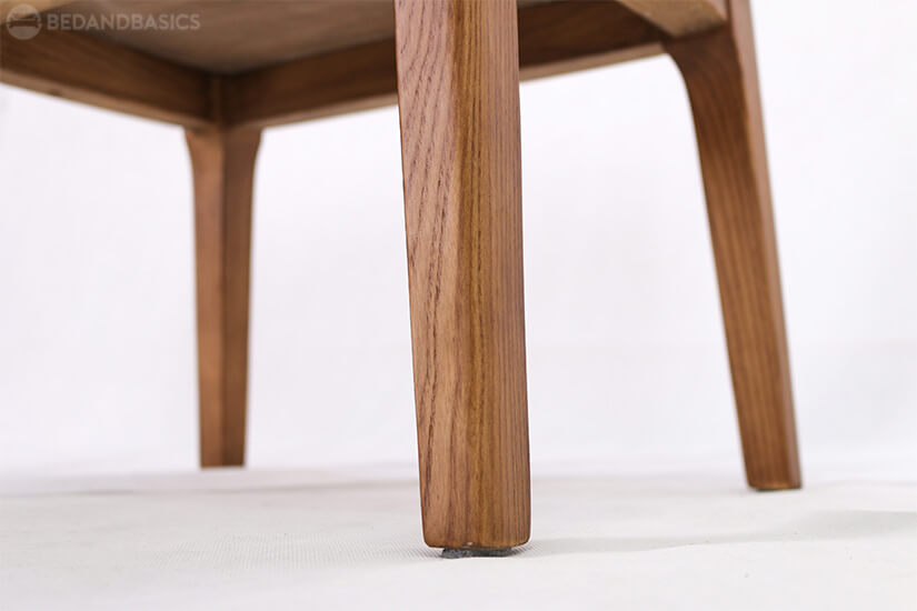 Slim tapered wooden legs allow for easy cleaning.