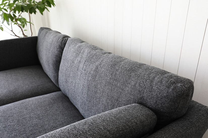 Textured fabric upholstery that adds dimensionality to its design.