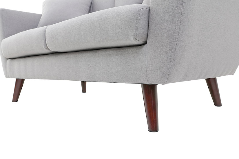 Supported by round tapered solid wood legs.