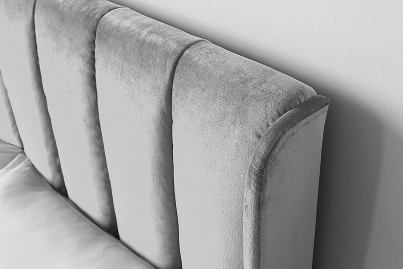 Fabric piping along its edges creates a fuller appearance. Lean back on this padded headboard for the perfect relaxation.