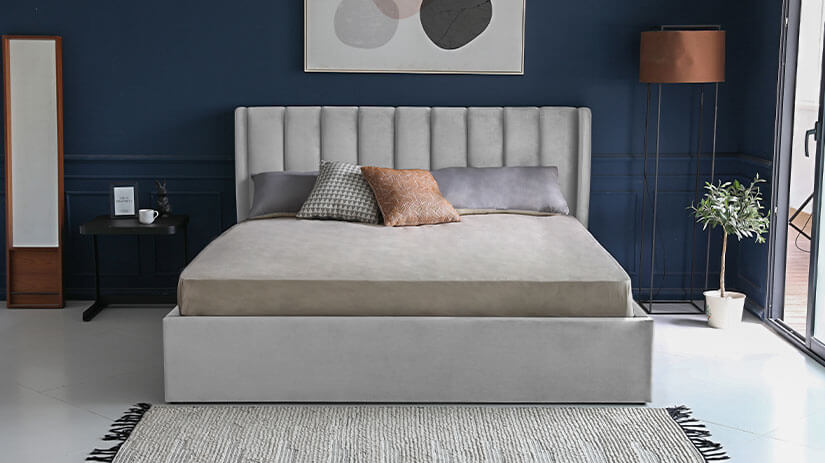 High headboard. Vertical channel tufting. A tall, majestic appearance. Elegance and functionality in one bed frame.