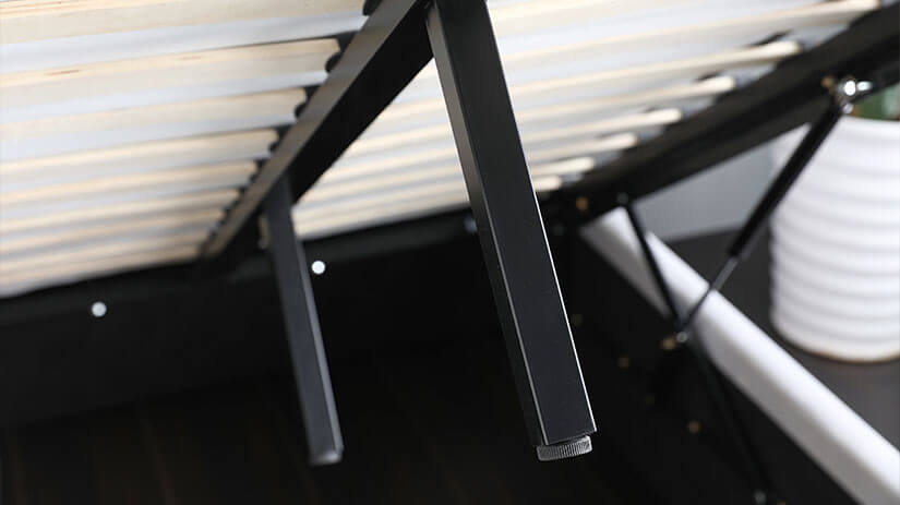 Two middle support legs with adjustable swivels support the bed board slates, enhancing stability of the bed frame.