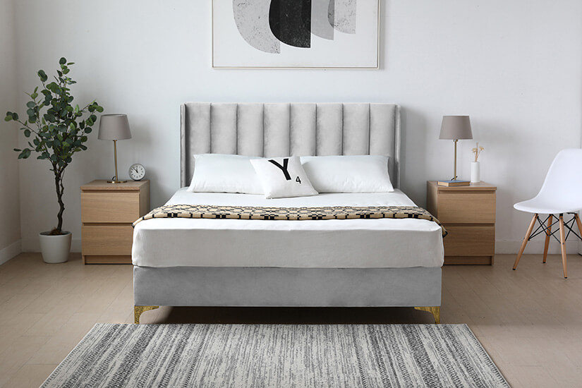 High headboard. Vertical channel tufting. A tall, majestic appearance. Internal structure a combination of Eucalyptus solid wood and plywood. A design made for durability.