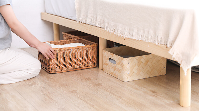 Maximise storage space under your bed by using storage boxes.