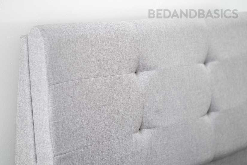 Textured fabric and tuftings that add dimensionality to the bed frame's overall design.