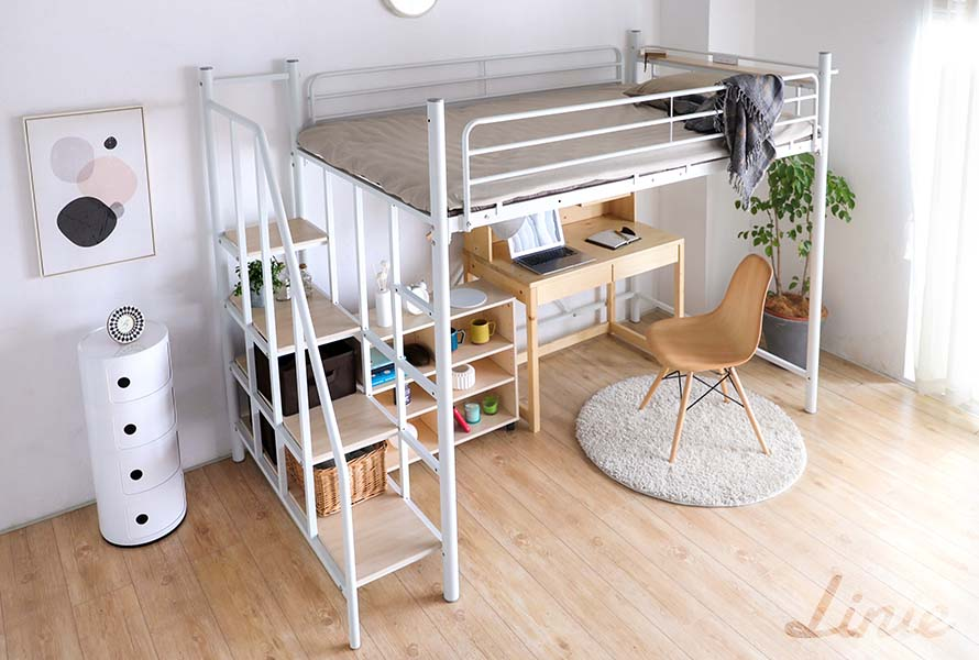 The Linie metal loft bed in white color in a bright bedroom