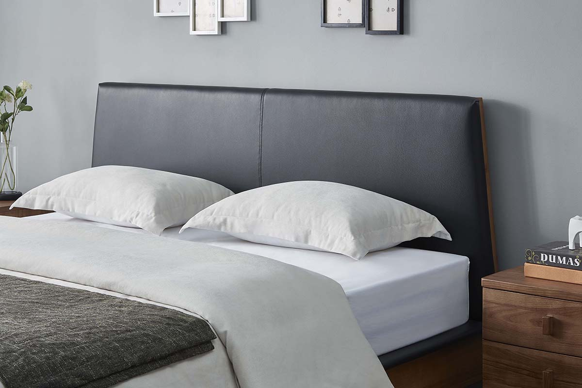 An overlay of high quality faux leather accentuates the headboard.