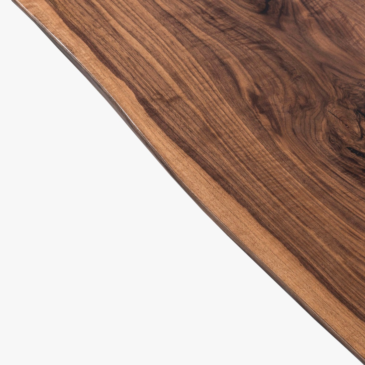 The living edges are retained to celebrate the natural origins and character of the wood.
